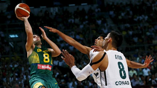 Brazil's Victor Benite goes for the basket against Mexico's Gustavo Ayon during their 2015 FIBA Americas Championship basketball game, at the Sport Palace in Mexico City