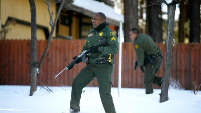 San Bernadino County sheriffs search a home for Christopher Dorner on Feb. 10.