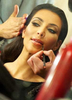 What would Kim Kardshian look like without all of that makeup?