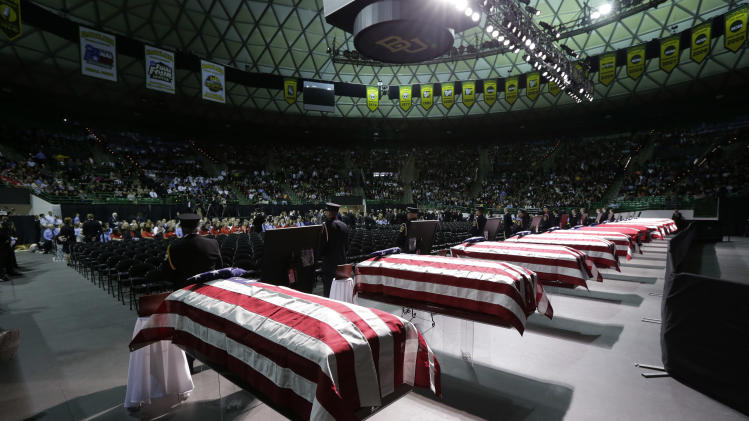 Honor guard stand in front of caskets prior to a memorial service for first responders who died in last week's fertilizer plant explosion in West, Texas, Thursday, April 25, 2013, in Waco, Texas.  President Barack Obama, U.S. Sen. John Cornyn and Texas Gov. Rick Perry are set to speak at Thursday's memorial at Baylor University's Ferrell Center in Waco. Firefighters and other first responders were among those killed when a fire at the plant erupted in an explosion last week. Hundreds of people were injured. (AP Photo/Eric Gay)