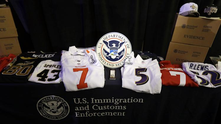 Feds: $13.6M in phony sports goods confiscated