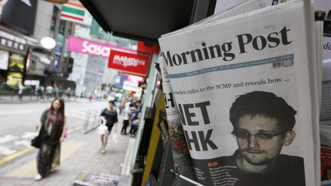 The picture of Edward Snowden, a former CIA employee who leaked top-secret documents about sweeping U.S. surveillance programs, is displayed on the front page of South China Morning Post at a news stand in Hong Kong Thursday, June 13, 2013. Snowden dropped out of sight after checking out of a Hong Kong hotel on Monday. The South China Morning Post newspaper said it was able to locate and interview him on Wednesday. It provided brief excerpts from the interview on its website. (AP Photo/Kin Cheung)