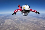 Pilot Felix Baumgartner of Austria performs during the first high altitude test jump from an airplane for the Red Bull Stratos mission in Taft, Calif., on Feb. 20 2012.