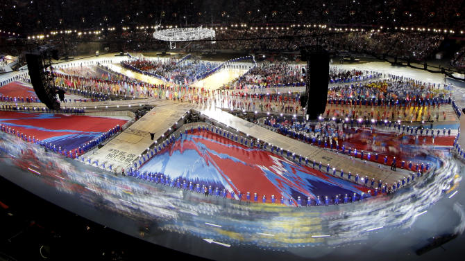 Athletes enter the Olympic Stadium during the Closing Ceremony at the 2012 Summer Olympics, Sunday, Aug. 12, 2012, in London. (AP Photo/David J. Phillip)
