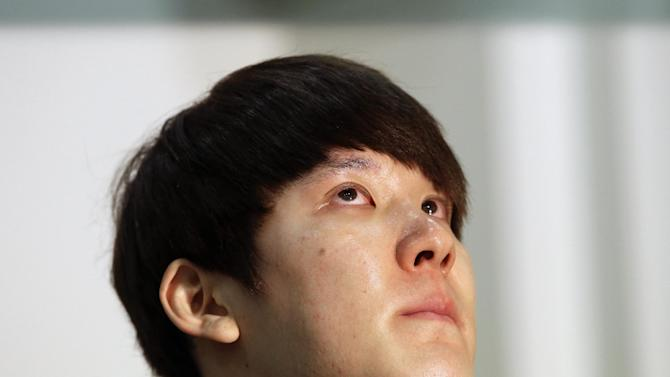 In this Friday, March 27, 2015, file photo, Former Olympic swimming champion Park Tae-hwan of South Korea holds back tears during a news conference in Seoul, South Korea. Former Olympic swimming champion Park Tae-hwan of South Korea offered a public apology Friday, four days after receiving an 18-month ban for failing a doping test. (AP Photo/Lee Jin-man)