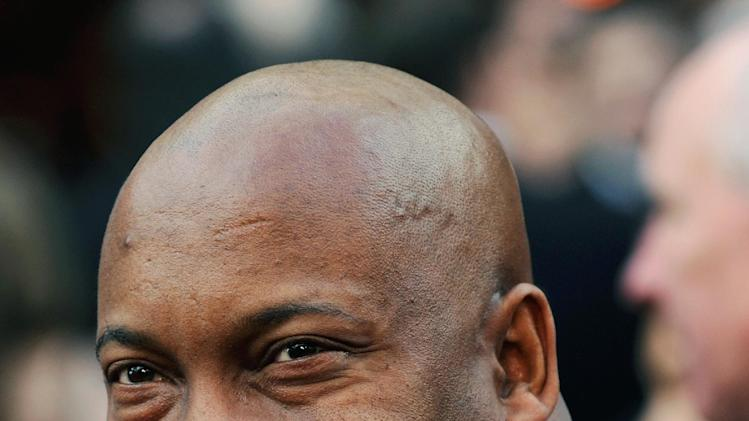 "FILE - In this file photo taken Feb. 24, 2008, director John Singleton arrives for the annual Academy Awards in Los Angeles. Singleton and Paramount Pictures on Nov. 1, 2012 settled a lawsuit filed by the director/producer that claimed the studio reneged on a contract to allow his company to produce two additional films after the release of 2005's ""Hustle & Flow,"" which received two Oscar nominations. (AP Photo/Chris Pizzello, File)"