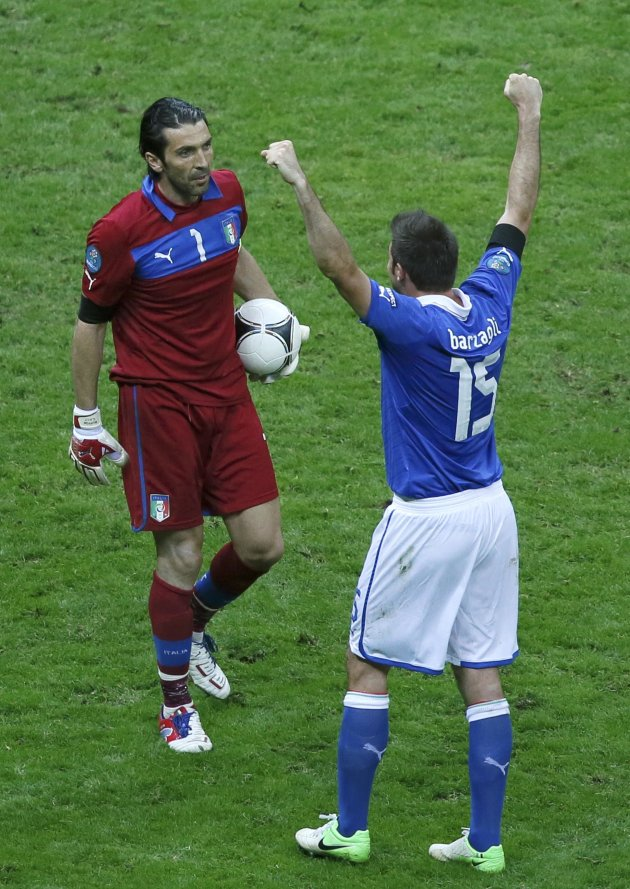 Italy's goalkeeper Buffon and Barzagli celebrate their victory against Germany after the Euro 2012 semi-final soccer match at the National stadium in Warsaw