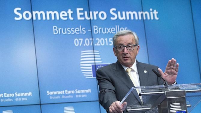 European Commission President Jean Claude Juncker speaks during a news conference at the end of a euro zone EU leaders emergency summit on the situation in Greece in Brussels