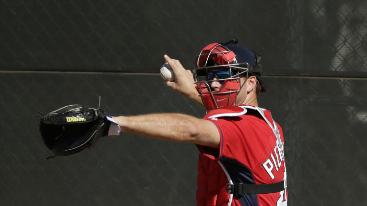 Boston Red Sox catcher A.J. Pierzynski works out in the bullpen during spring training baseball practice Monday, Feb. 17, 2014, in Fort Myers, Fla. (AP Photo/Steven Senne)