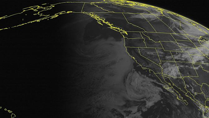 This NOAA satellite image taken Friday, September 7, 2012 at 11:00 AM EDT shows showers and thunderstorms over Arizona. A cold front extends into the central and northern Rockies with areas of showers. Clear skies are seen over much of the Northwest United States. (AP PHOTO/WEATHER UNDERGROUND)