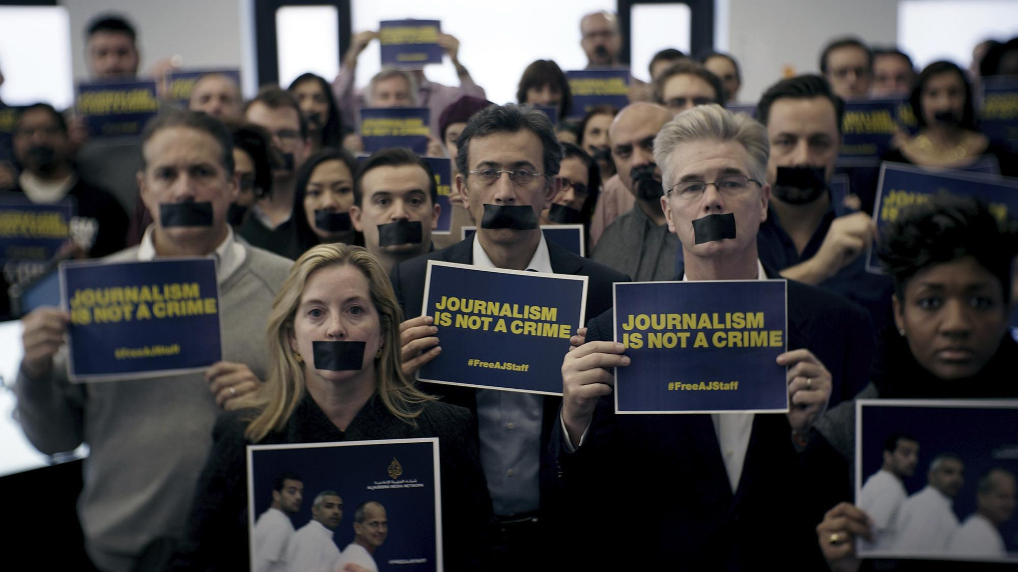 Al Jazeera America Marks Anniversary of Egypt Arrests with 'Journalism Is Not a Crime' Special