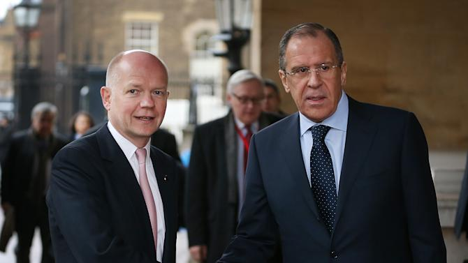 British Foreign Secretary William Hague, left, greets Russian Foreign Minister Sergey Lavrov at the G8 Foreign Ministers meeting at Lancaster House Thursday April 11, 2013 in London, England. G8 Foreign Ministers are holding a two day meeting where they will discuss the situation in the Middle East, including Syria and Iran, security and stability across North and West Africa, Democratic People's Republic of Korea and climate change. British Foreign Secretary William Hague will also highlight five key policy priorities.  (AP Photo / Peter Macdiarmid , pool