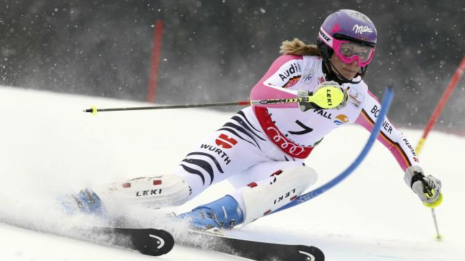 Germany's†Maria†Hoefl-Riesch clears a gate during the first run of the women's slalom, at the Alpine skiing world championships in Schladming, Austria, Saturday, Feb.16, 2013. (AP Photo/Alessandro Trovati)