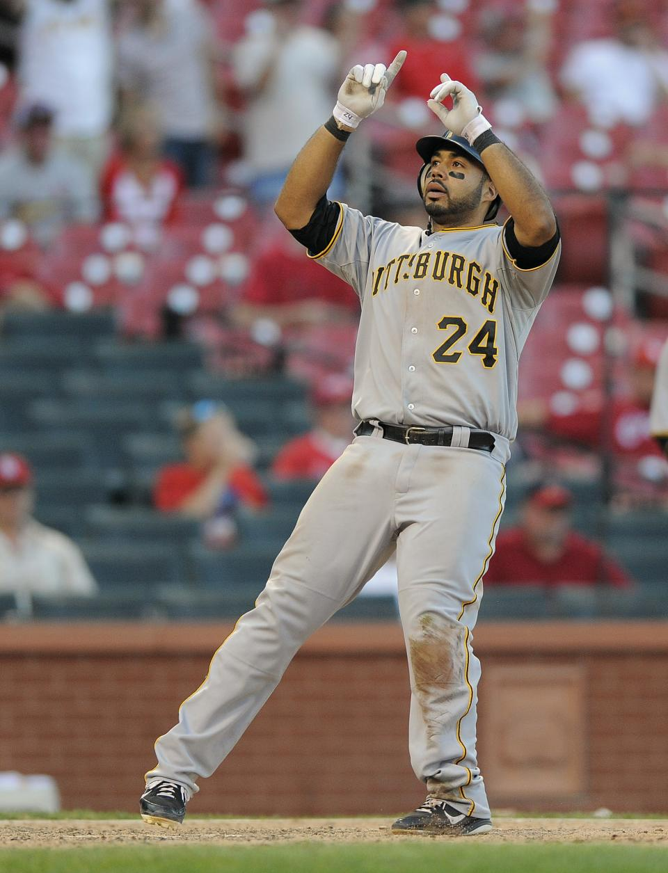 Pittsburgh Pirates' Pedro Alvarez gestures after hitting a solo home run off St. Louis Cardinals relief pitcher Barret Browning during the 19th inning of a baseball game on Sunday, Aug. 19, 2012, in St. Louis. The Pirates won 6-3 in 19 innings. (AP Photo/Jeff Curry)