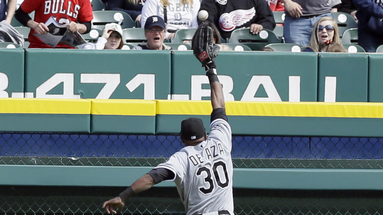 Chicago White Sox left fielder Alejandro De Aza chases an RBI-double hit by Detroit Tigers' Rajai Davis during the eighth inning of a baseball game in Detroit, Thursday, April 24, 2014. (AP Photo/Carlos Osorio)