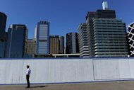 This file photo shows skyline of the central business district at Sydney's Darling Harbour, pictured in September. Australian Treasurer Wayne Swan on Saturday welcomed a decision by ratings agency Fitch to affirm the country's AAA credit rating, days after his mid-year economic review lowered this year's growth forecast