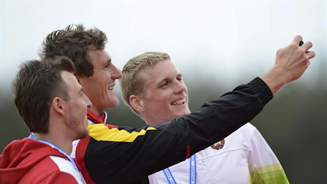 . Racice (Czech Republic), 03/05/2015.- (L-R) Silver medalist Russian's Pavel Petrov, Goldmedalist German's Sebastian Brendel and Bronze medalist Belorussian's Maksim Piatrou take a selfie on the podium of the men's C-1 5000m final at the Canoe Sprint European Championships in Racice, Czech Republic, 03 May 2015. EFE/EPA/RENE VOLFIK
