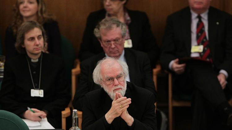 Dr Rowan Williams, centre, the outgoing Archbishop of Canterbury listens during a meeting of the General Synod of the Church of England  in central London, Tuesday, Nov. 20, 2012,  - where a vote on whether to give final approval to legislation introducing the first women bishops will take place. The leader of the Church of England appealed for harmony among the faithful as it went into a vote Tuesday on whether to allow women to serve as bishops, a historic decision that comes after decades of debate. The push to muster a two-thirds majority among lay members of the General Synod is expected to be close, with many on both sides unsatisfied with a compromise proposal to accommodate individual parishes which spurn female bishops. (AP Photo/PA, Yui Mok)  UNITED KINGDOM OUT  NO SALES  NO ARCHIVE