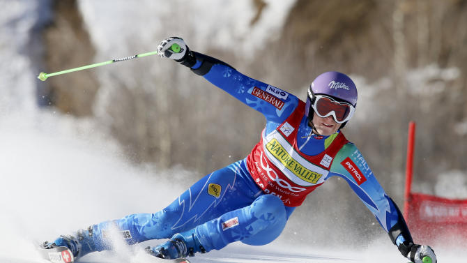 CORRECTS DATE - Tina Maze from Slovenia, races down the course during the women's World Cup giant slalom ski race in Aspen, Colo., on Saturday, Nov. 24, 2012.  (AP Photo/ Nathan Bilow)