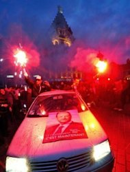 Supporters of France's Socialist Party (PS) newly elected president celebrate with smoke bombs from a car, at the Grande Place in Lille after the announcement of the first official results of the second round of Presidential election