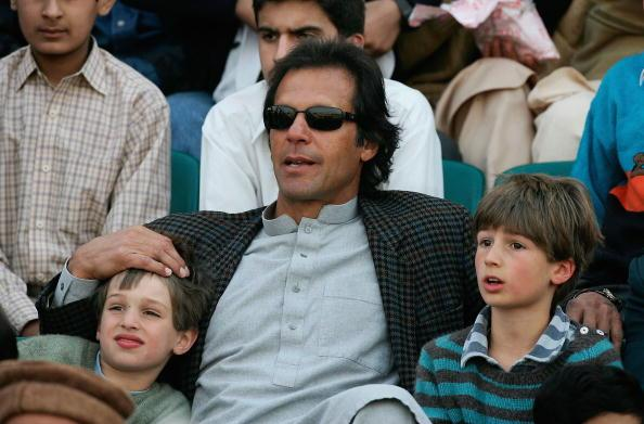 RAWALPINDI, PAKISTAN - DECEMBER 19:  Former Pakistan cricket team captain Imran Khan and his sons Qasim and Suleiman Khan watch the action during the fourth one day international match between Pakista