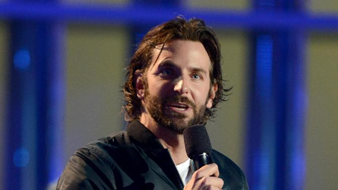 """IMAGE DISTRIBUTED FOR MTV - Actor Bradley Cooper accepts the award for best male performance for """"Silver Linings Playbook"""" at the MTV Movie Awards in Sony Pictures Studio Lot in Culver City, Calif., on Sunday April 14, 2013. (Photo by Jordan Strauss/Invision for MTV/AP Images)"""