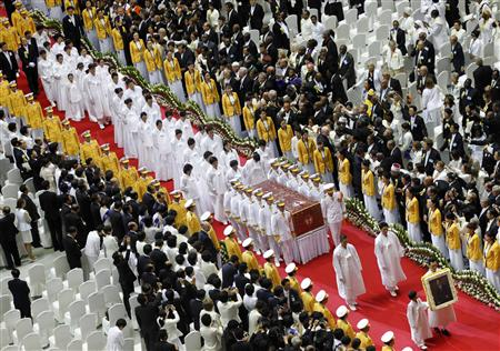 Honor guards carry the body of Sun Myung Moon as his family members follow during a funeral service for the late founder of the Unification Church, at the CheongShim Peace World Center in Gapyeong,