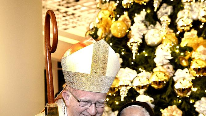 Orange County Bishop Kevin Vann talks with Sister Catalina Bayardo of Garden Grove after his Excellency lighted the Christmas tree in the Cathedral Cultural Center on Wednesday, Dec. 24, 2014, in Garden Grove, Calif. (AP Photo/The Orange County Register, Bill Alkofer)