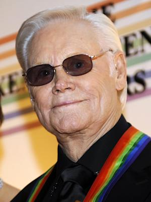 FILE - In this Dec. 7, 2008 file photo, George Jones arrives for the Kennedy Center Honors at the Kennedy Center in Washington. Jones made a family feud public when he posted a video message on his website Wednesday, April 25, 2012, thanking fans as he recovers from an upper respiratory infection and accusing his daughter, Georgette, of spreading lies about him on the Internet, which she denies. (AP Photo/Jacquelyn Martin, File)
