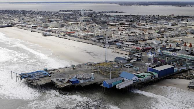 "FILE - This Oct. 31, 2012 file aerial photo shows the damage to an amusement park left in the wake of Superstorm Sandy, in Seaside Heights, N.J. The National Hurricane Center now says tropical force winds from Sandy extended 820 miles at its widest, down from an earlier estimate of 1,000 miles. Its pure kinetic energy for storm surge and wave ""destruction potential"" reached a 5.8 on the National Oceanic and Atmospheric Administration's 0 to 6 scale, the highest measured. (AP Photo/Mike Groll, File)"