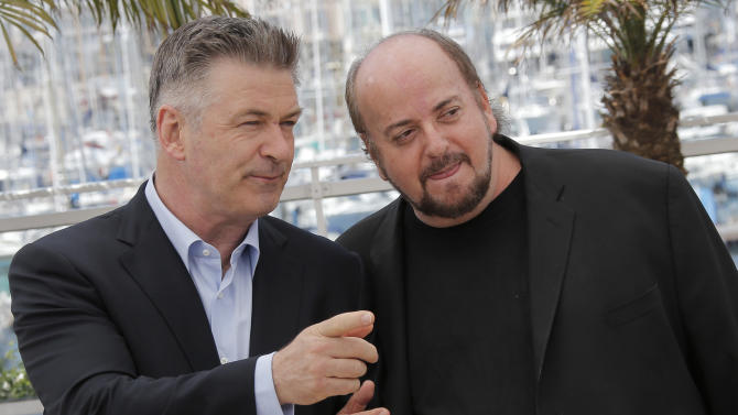 Actor Alec Baldwin, left, speaks with director James Toback during a photo call for the film Seduced and Abandoned at the 66th international film festival, in Cannes, southern France, Tuesday, May 21, 2013. (AP Photo/Lionel Cironneau)