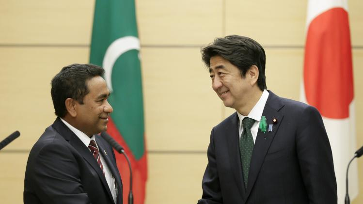 Japanese PM Abe shakes hands with Maldives' President Yameen in Tokyo