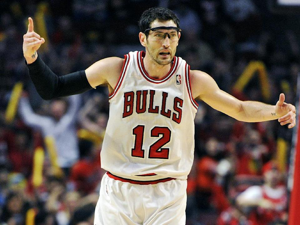 Chicago Bulls' Kirk Hinrich (12) celebrates a 3-point basket against the Brooklyn Nets  during the first half in Game 4 of their first-round NBA basketball playoff series Saturday, April 27, 2013, in Chicago. (AP Photo/Jim Prisching)