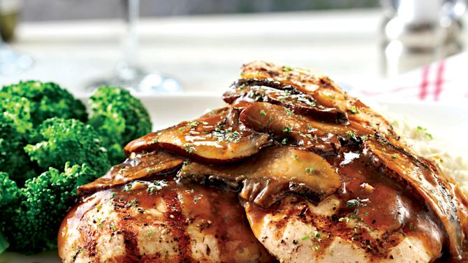 This undated image provided by Red Lobster shows the restaurant's new Chicken with Portobello dish. The chain that brought seafood to the masses is hoping to broaden its appeal by revamping its menu on Oct. 15 to boost the number of dishes that cater to diners who don't want seafood, including lighter options such as salads. Red Lobster also is increasing the number of dishes that cost less than $15 to attract customers who have cut back on spending. (AP Photo/Red Lobster)
