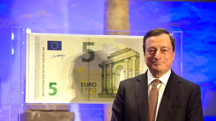 "European Central Bank ECB President Mario Draghi unveils the new 5 euro banknote at the Archaeological Museum in Frankfurt, Germany,  Thursday Jan. 10, 2013 . The exhibition "" (AP Photo/dpa/Boris Roessler)"