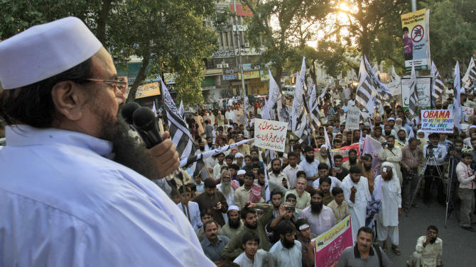 Hafiz Saeed, leader of Pakistani religious group Jamaat-ud-Dawa, left, delivers a speech during a protest against a film insulting the Prophet Muhammad, in Lahore, Pakistan, Sunday, Sept. 30, 2012. (AP Photo/K.M. Chaudary)