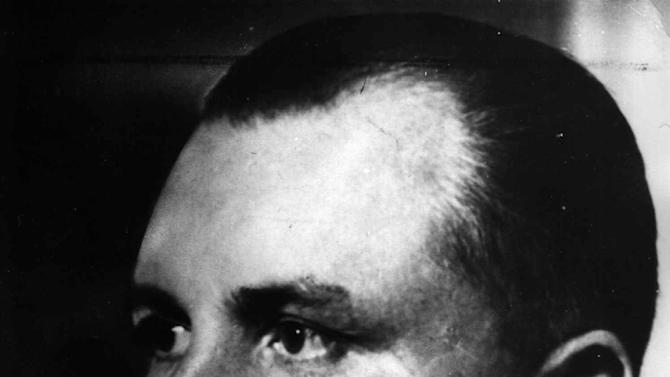 FILE - This undated black and white file photo shows Adolf Hitler's secretary Martin Bormann. Even though Sergei Magnitsky died more than three years ago, he is to go on trial next month in a Russian court. The whistleblowing lawyer died in jail in 2009 after being arrested on charges of tax fraud -- the same fraud in which he alleged Interior Ministry officials had a hand. The plan to bring a dead man to trial adds to the harsh international criticism heaped on Russia over the matter. The court proceedings set to start Feb. 18, 2013 echo some other posthumous trials. Martin Bormann, , the personal secretary to Adolf Hitler, was tried in absentia at the Nuremberg tribunal and sentenced to death _ which in the end proved to be superfluous. At the time of the 1946 trial, the whereabouts of the powerful Nazi official were unknown _ and for decades after the war he was considered one of the most-wanted Nazi war criminals. In 1972 during construction work in downtown Berlin bones were unearthed that were identified as having belonged to Bormann through dental records _ and the location fit with an account that Bormann had committed suicide to avoid falling into enemy hands as he attempted to flee Berlin in the final days of the war in May 1945. But rumors persisted that Bormann had found his way to South America, until DNA tests done in 1998 conclusively proved that the remains found in Berlin were those of Bormann. (AP Photo/File)