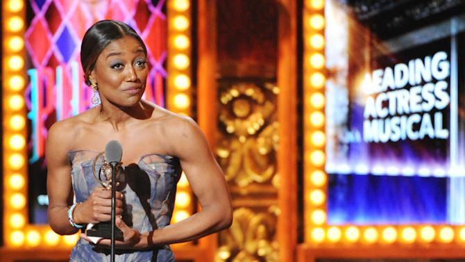 "Patina Miller accepts her Tony Award for best actress in a musical for her role in ""Pippin"" at the 67th Annual Tony Awards, on Sunday, June 9, 2013 in New York.  (Photo by Evan Agostini/Invision/AP)"