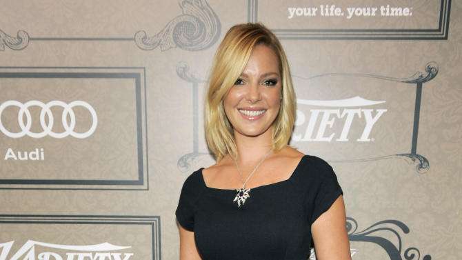 """FILE - In this Oct. 5, 2012 file photo, actress Katherine Heigl poses at Variety's 4th annual Power of Women event in Beverly Hills, Calif. Heigl will star as a CIA analyst in the new NBC series """"State of Affairs"""" also starring Alfre Woodard as the U.S. president. (Photo by Chris Pizzello/Invision/AP, File)"""
