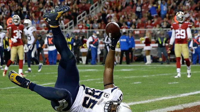 Tight end Antonio Gates #85 of the San Diego Chargers catches a touchdown against the San Francisco 49ers on December 20, 2014 in Santa Clara, California