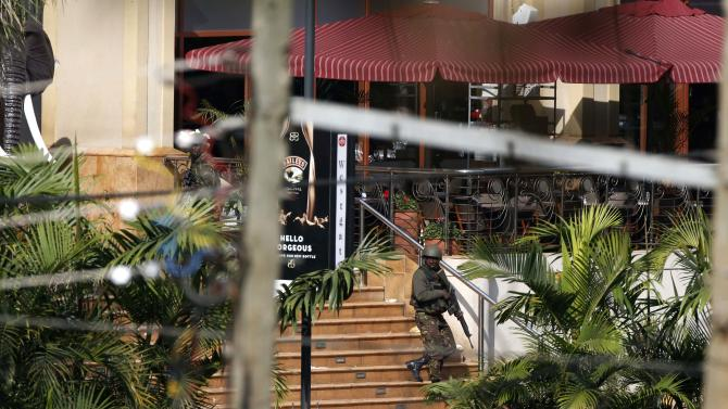 A Kenyan soldier walks out of the main gate of Westgate Shopping Centre in Nairobi