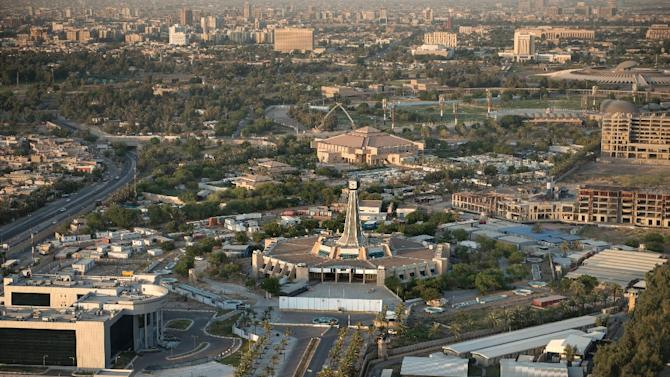 A general view taken from a helicopter shows the Baghdad clock tower in Harthiya Sqaure in the west of the Iraqi capital, on September 10, 2014