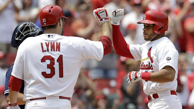 St. Louis Cardinals' Tommy Pham, right, is congratulated by teammate Lance Lynn after hitting a two-run home run during the third inning of a baseball game against the San Diego Padres, Sunday, July 5, 2015, in St. Louis. (AP Photo/Jeff Roberson)