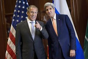 Russia's Foreign Minister Sergey Lavrov and U.S. Secretary of State John Kerry talk before a trilateral meeting in Doha