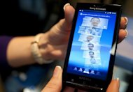 "<p>The new ""Xperia""mobile phone by Sony Ericsson is displayed in Barcelona, in 2010. Sony said Thursday it would chop 15 percent of the workforce at its struggling mobile phone unit and move its headquarters to Tokyo from Sweden as the Japanese consumer electronics giant slashes costs.</p>"