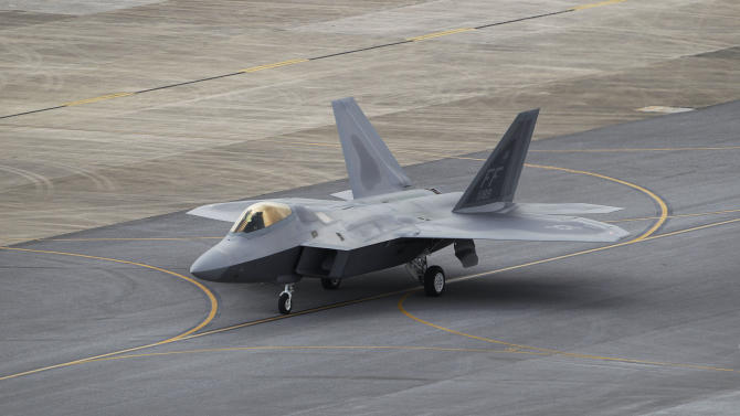 In this Aug. 14, 2012 photo, a U.S. Air Force F-22 Raptor stealth fighter taxis before take-off at Kadena Air Base on the southern island of Okinawa in Japan. The U.S. is hoping a dozen F-22 stealth fighters now roaring through the skies of southern Japan will prove its most prized combat aircraft is finally ready to resume full operations after years of investigations into why its pilots were getting dizzy and disoriented. But questions remain over whether the Air Force has taken enough action to fix a potentially bigger problem - the shriveling of programs to test cockpit life support systems after nearly 20 years of budget cuts, downsizing and outsourcing. (AP Photo/Greg Baker)