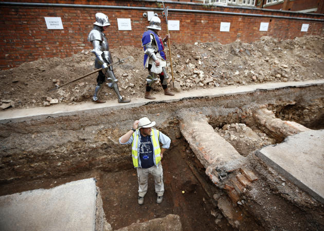 Archaeologist Mathew Morris stands in the trench where he found skeleton remains during an archaelogical dig to find the remains of King Richard III in Leicester