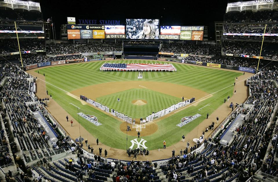 Jenna Ushkowitz sings the National Anthem before the start of Game 1 of the American League championship series between the New York Yankees and Detroit Tigers Sunday, Oct. 14, 2012, in New York. (AP Photo/Peter Morgan)