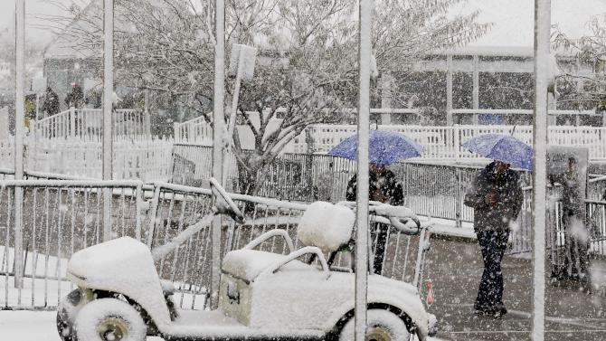 Snow covers a golf cart outside the course clubhouse during the Match Play Championship golf tournament, Wednesday, Feb. 20, 2013, in Marana, Ariz. Play was suspended for the day. (AP Photo/Ted S. Warren)