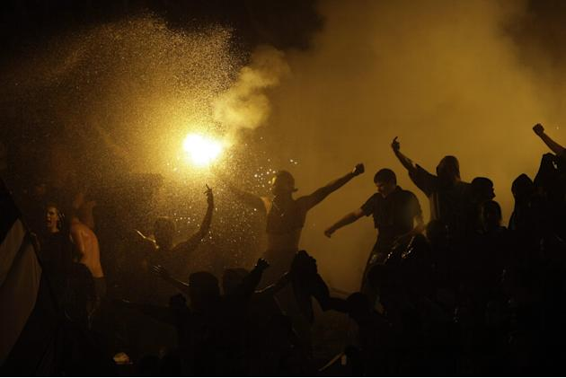 Partizan Belgrade fans ignite flares during their team's Serbian league soccer game against arch rivals Red Star in Belgrade, Serbia, Saturday, Nov. 2, 2013. Violence on the stands during soccer match